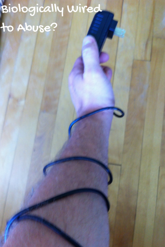 Image of man's arm with wire wrapped around it.