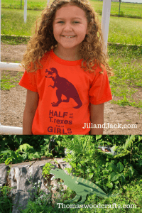 """Image of a girl wearing a t-rex t-shirt with text """"Half of all T-rexes were girls"""" and image of a wooden t-rex clothes hook from Thomas Woodcrafts"""