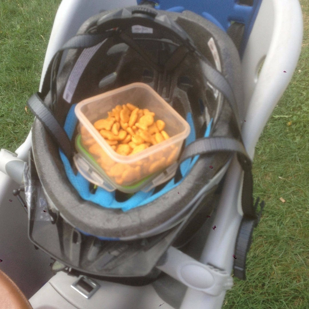 image of a container of goldfish crackers sitting in a bike helmet