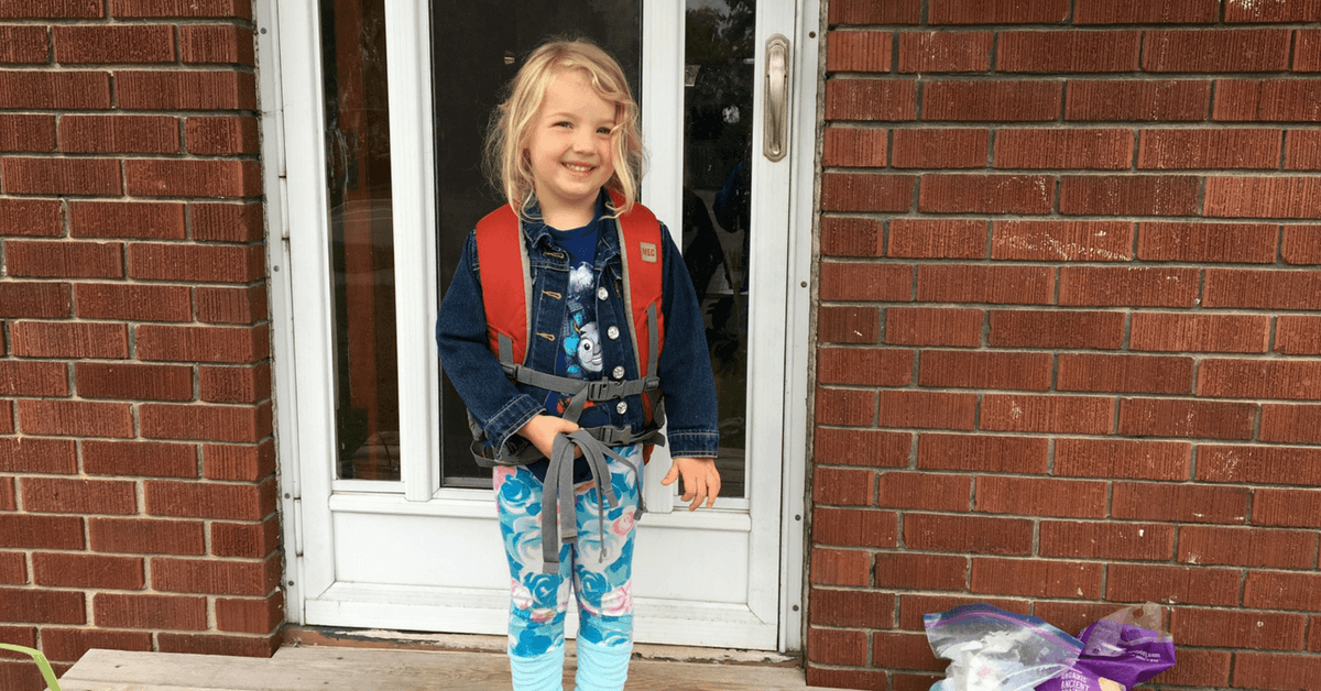 Image of a kid on her first day of kindergarten
