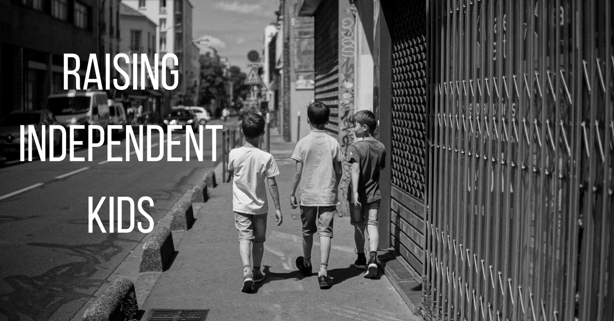 Image of three independent kids walking on a city street